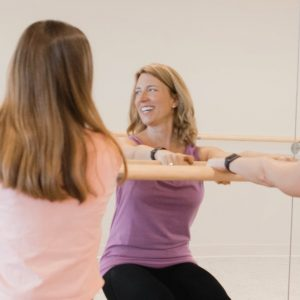 Mother and Daughter working out at the ballet barre